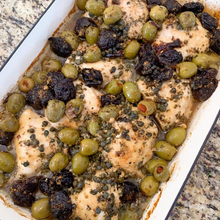 chicken marbella in a casserole dish
