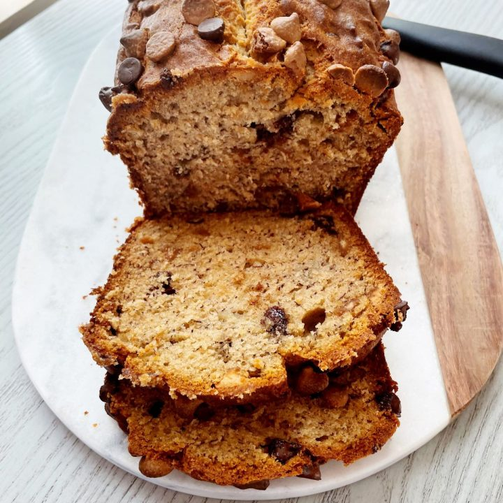 peanut butter chocolate chip banana bread with 2 slices cut off of loaf