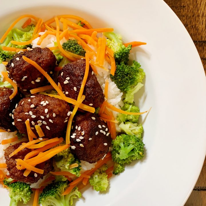 Turkey Bulgogi Meatballs with carrots and broccoli on top of rice
