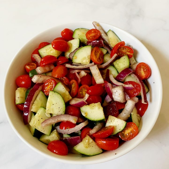 Salad in a white bowl