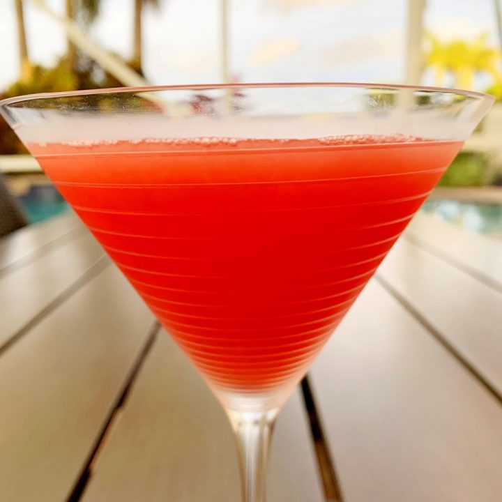 Watermelon Martini in a glass on a patio table outside