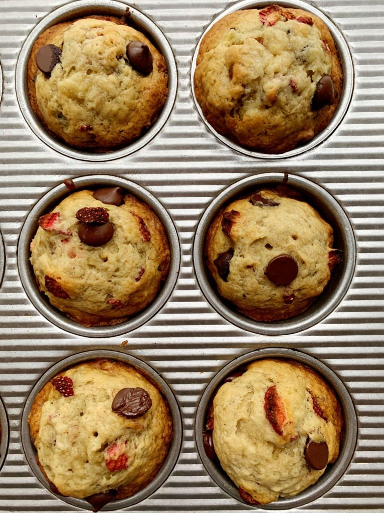 Close up of strawberry dark chocolate banana muffins in a muffin pan