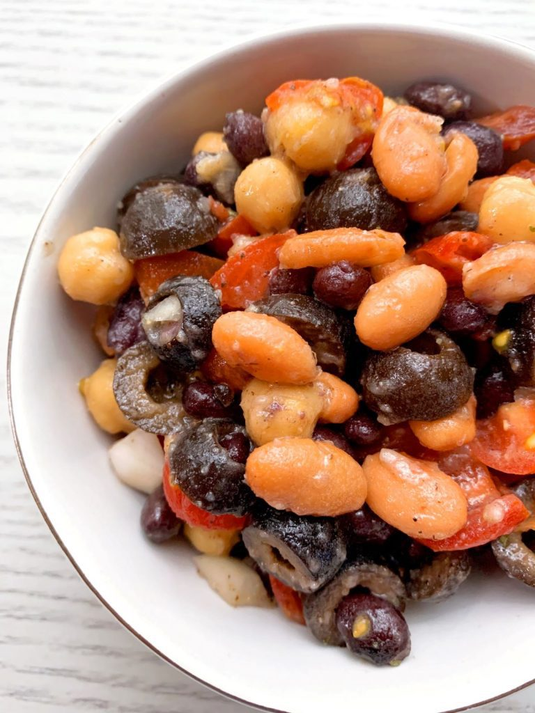 close up of three bean salsa in a bowl on gray counter