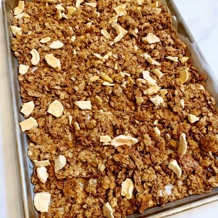 Apple Cinnamon Flax Seed Granola baked on a sheet pan
