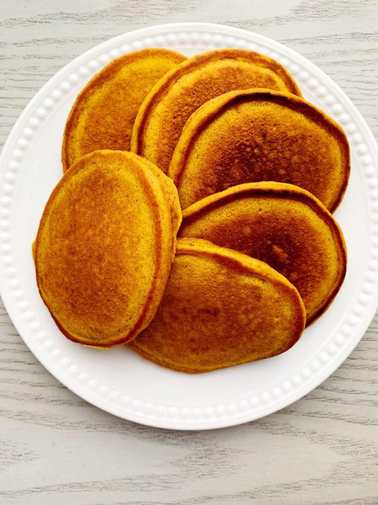 Pumpkin Pancakes on a white plate.