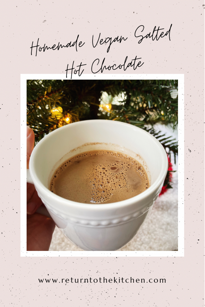 close up of homemade vegan salted hot chocolate in a white mug