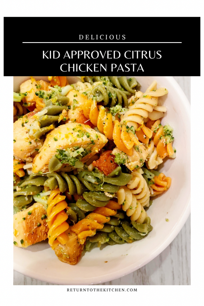 close up of kid approved citrus chicken pasta in a white bowl