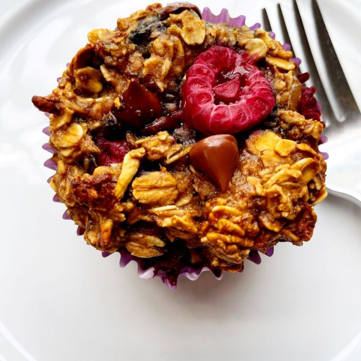 Raspberry Chocolate Chip Baked Oatmeal Muffins on a white plate with a fork