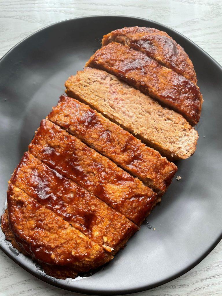turkey meatloaf sliced on a black plate