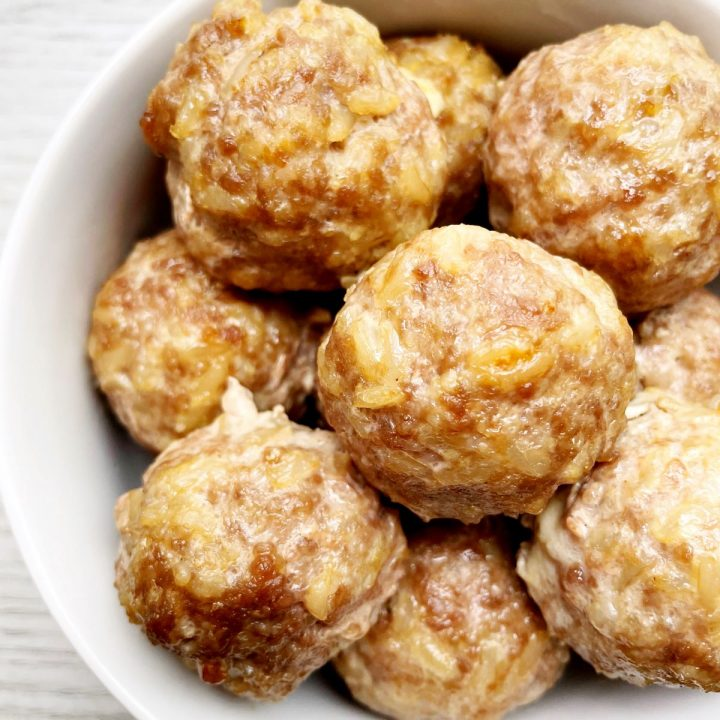 pork and brown rice meatballs in a white bowl
