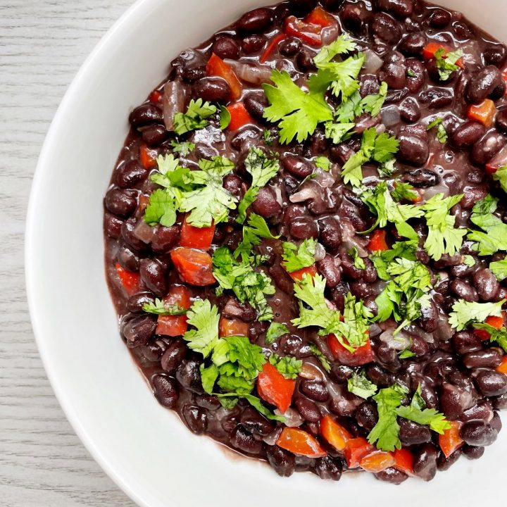 simple black beans in a white bowl