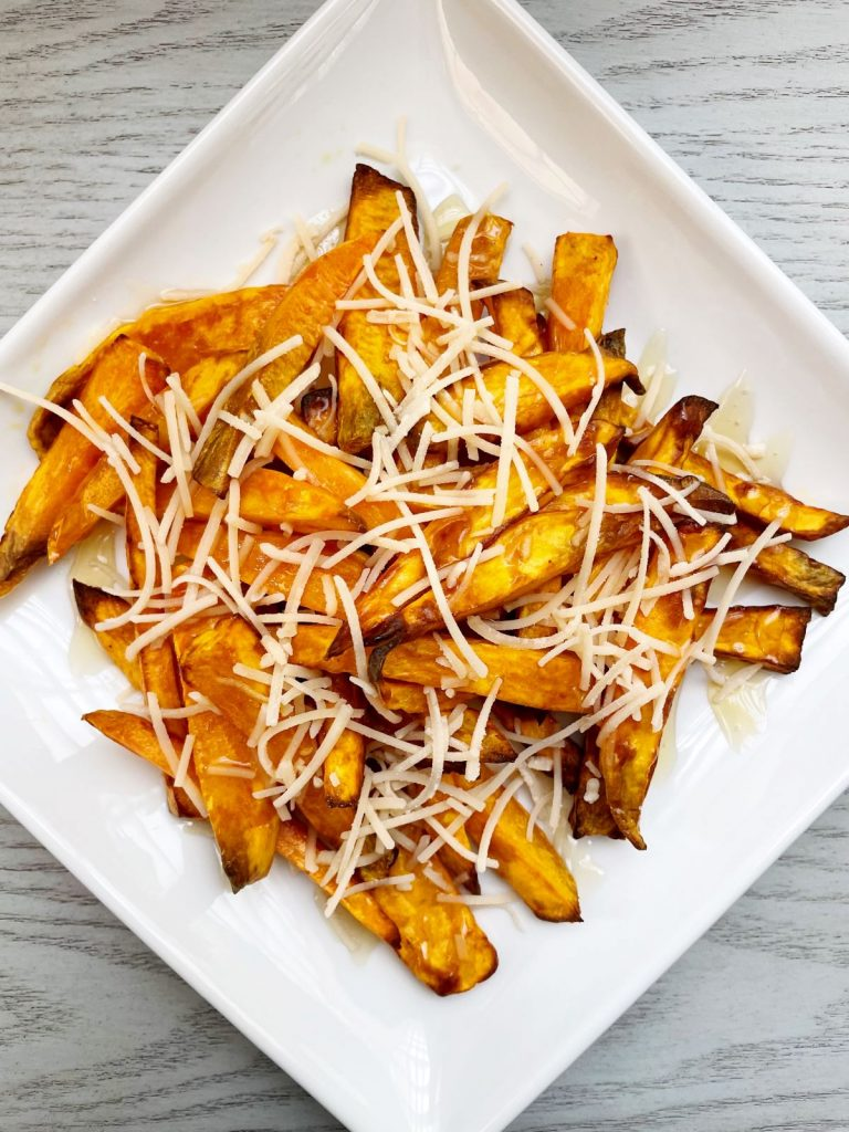 Air Fryer Sweet Potato Fries with Honey and Parmesan Cheese on a square white plate