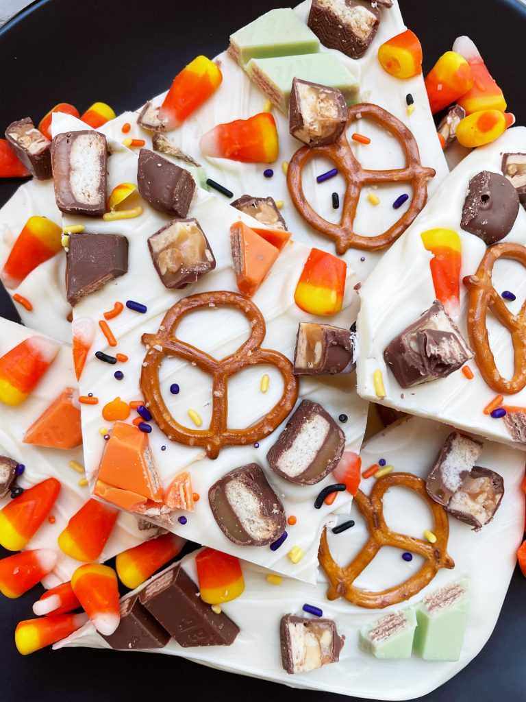 easy leftover halloween candy bark on a black plate
