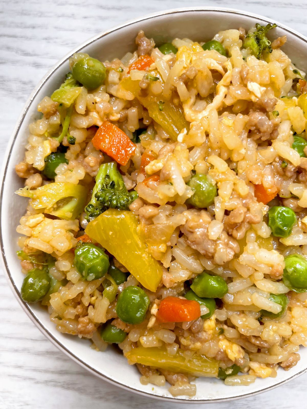 one pot pineapple pork fried rice in a white bowl