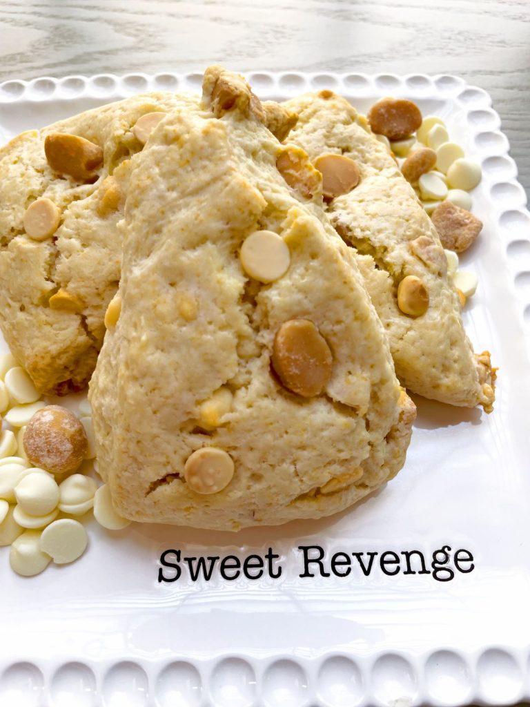 white chocolate macadamia nut scones on a white plate